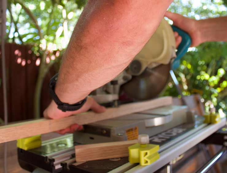 Photo of Bamboo Blinds Australia staff working a drop saw in the workshop