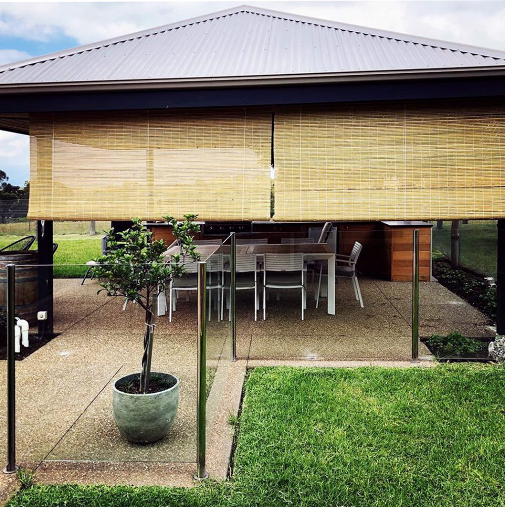Natural Bamboo blinds providing privacy and protection for a pergola