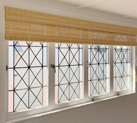 Raw bamboo rollup blinds with clear lacquered finish